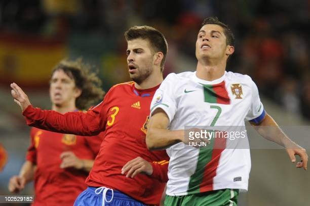 Spain's defender Gerard Pique and Portugal's striker Cristiano Ronaldo fight for the ball during the 2010 World Cup Round of 16 football match...