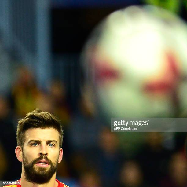 Spain's defender Gerard Pique eyes the ball during the international friendly football match Spain against Costa Rica at La Rosaleda stadium in...