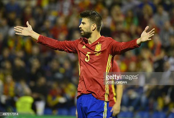 Spain's defender Gerard Pique gestures during the friendly football match Spain vs England at the Jose Rico Perez stadium in Alicante on November 13...