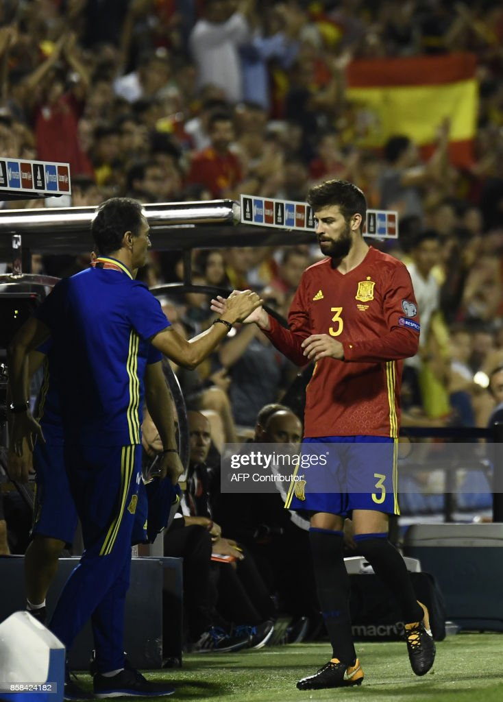Spain's defender Gerard Pique leaves the field during the World Cup 2018 qualifier football match Spain vs Albania at the Jose Rico Perez stadium in Alicante on October 6, 2017. /