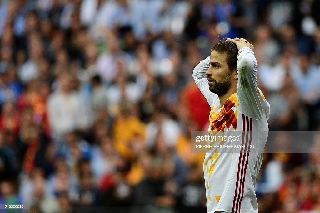 Spain's defender Gerard Pique reacts after the Euro 2016 round of 16 football match between Italy and Spain at the Stade de France stadium in Saint-Denis, near Paris, on June 27, 2016. MARCOU