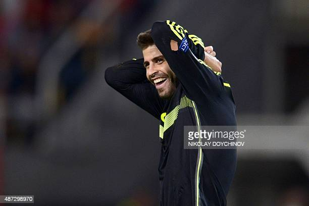 Spain's defender Gerard Pique reacts during the Euro 2016 Group C qualifying football match between Macedonia and Spain at the Filip II Arena stadium...