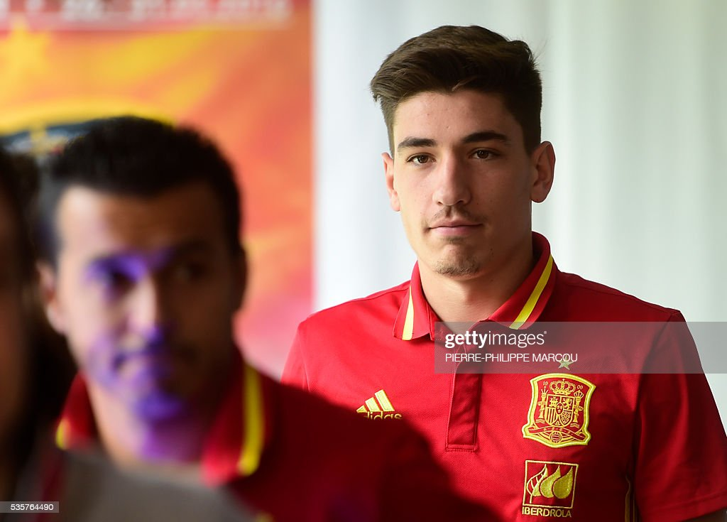 Spain's defender Hector Bellerin leaves the press conference room in Schruns on May 30, 2016 ahead of the upcoming Euro 2016 European football championships. / AFP / PIERRE