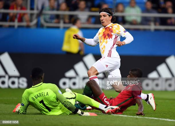 Spain's defender Hector Bellerin missed an opportunity to score past Portugal's defender Joao Cancelo and Portugal's goalkeeper Bruno Varela during...