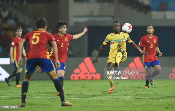 Spain's defender Hugo Guillamon and Mali's forward Lassana Ndiaye vie for the ball during the second semi final football match between Mali and Spain...