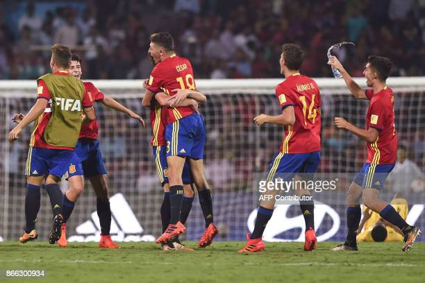 Spain's defender Hugo Guillamon Cesar Gelabert and teammates celebrate after winning their semifinal football match against Mali during the FIFA U17...