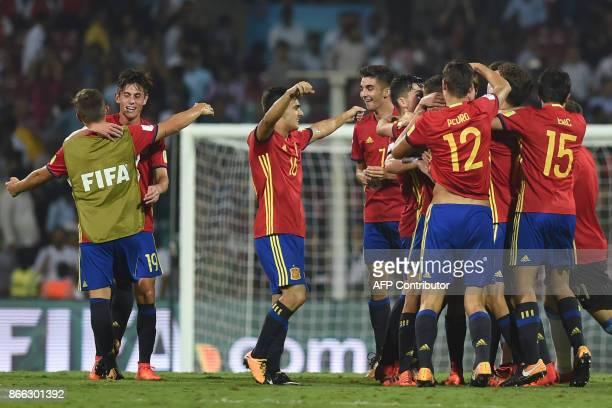 Spain's defender Hugo Guillamon forward Diego Pampin forward Ferran Torres and teammates celebrate after winning their semifinal football match...