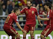 Spain's defender Jordi Alba celebrates with teammates after scoring a goal during the Euro 2016 qualifying football match Spain vs Slovakia at the...