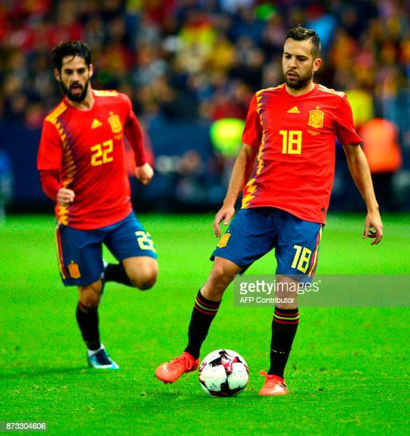 Spain's defender Jordi Alba controls the ball next to Spain's midfielder Isco during the international friendly football match Spain against Costa...