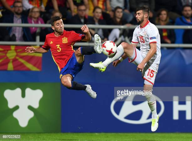 Spain's defender Jose Gaya and Macedonia's defender Egzon Bejtulai vie for the ball during the UEFA U21 European Championship Group B football match...