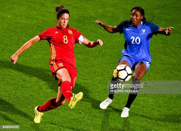 Spain's defender Marta Torrejon vies with France's midefielder Kadidiatou Diani during a friendly football match between France and Spain on...