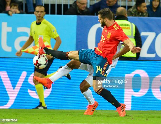 Spain's defender Nacho vies with Costa Rica's defender Jose Salvatierra during the international friendly football match Spain against Costa Rica at...