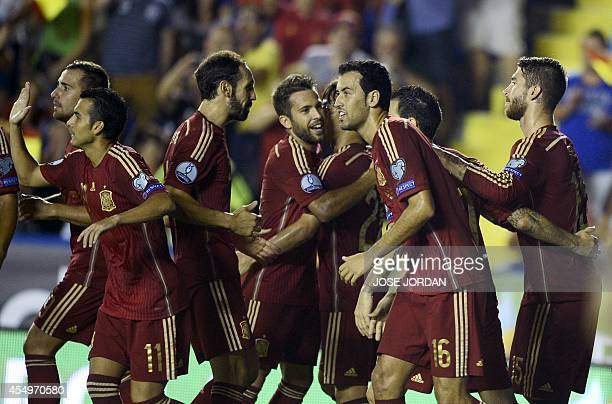 Spain's defender Sergio Ramos celebrates with his teammates after scoring during the UEFA Euro 2016 group D qualifying football match Spain vs...