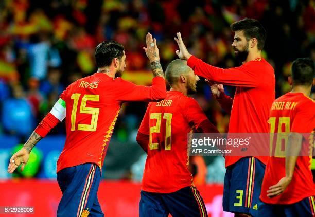 Spain's defender Sergio Ramos celebrates with Spain's defender Gerard Pique after Spain's forward Alvaro Morata scored a goal during the...