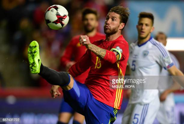 Spain's defender Sergio Ramos controls the ball during the WC 2018 group G football qualifing match Spain vs Israel at El Molinon stadium in Gijon on...
