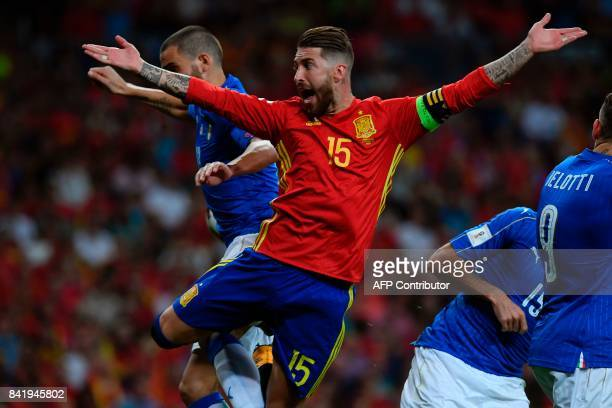 Spain's defender Sergio Ramos gestures during the World Cup 2018 qualifier football match Spain vs Italy at the Santiago Bernabeu stadium in Madrid...