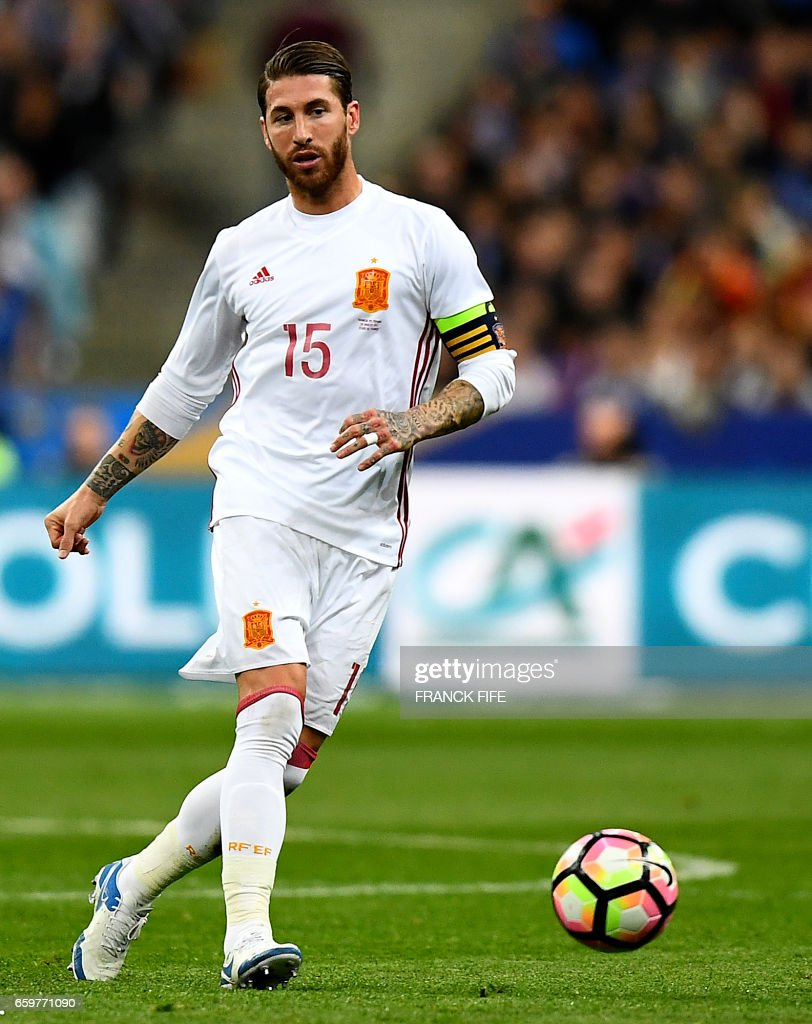 Spain s defender Sergio Ramos passes the ball during the friendly