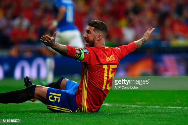 Spain's defender Sergio Ramos reacts after a fall during the World Cup 2018 qualifier football match Spain vs Italy at the Santiago Bernabeu stadium...