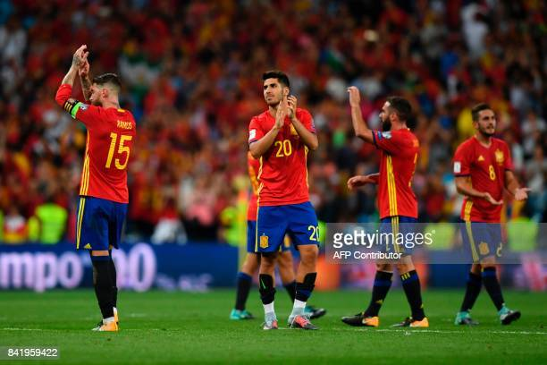Spain's defender Sergio Ramos Spain's midfielder Marco Asensio and teammates applaud at the end of the World Cup 2018 qualifier football match Spain...