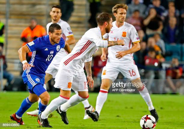 Spain's defender Sergio Ramos vies for the ball with Israel's forward Tomer Hemed during the Russia 2018 FIFA World Cup European Group G qualifying...