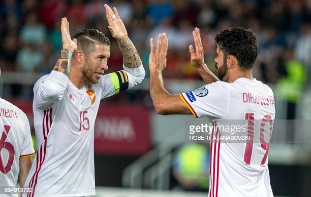 Spain's Diego Costa celebrates with teammate Sergio Ramos after scoring a goal during the FIFA World Cup 2018 qualifying football match between...