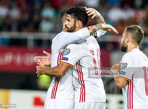 Spain's Diego Costa celebrates with teammate Sergio Ramos after scoring a goal during the FIFA World Cup 2018 qualification football match between...