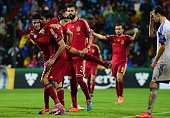 Spain's Diego Costa celebrates with teammates after scoring during the Group C Euro 2016 qualifying football match between Luxembourg and Spain at...
