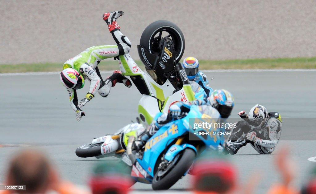 Spain's Ducati rider Aleix Espargaro and Frace's Honda driver Randy De Puniet crash during the Moto Grand Prix race of Germany at Sachsenring Circuit...