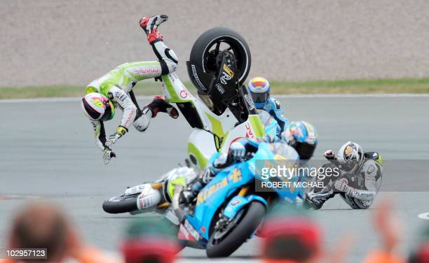 Spain's Ducati rider Aleix Espargaro and Frace's Honda driver Randy De Puniet crash during the Moto Grand Prix race of Germany at Sachsenring Circuit...