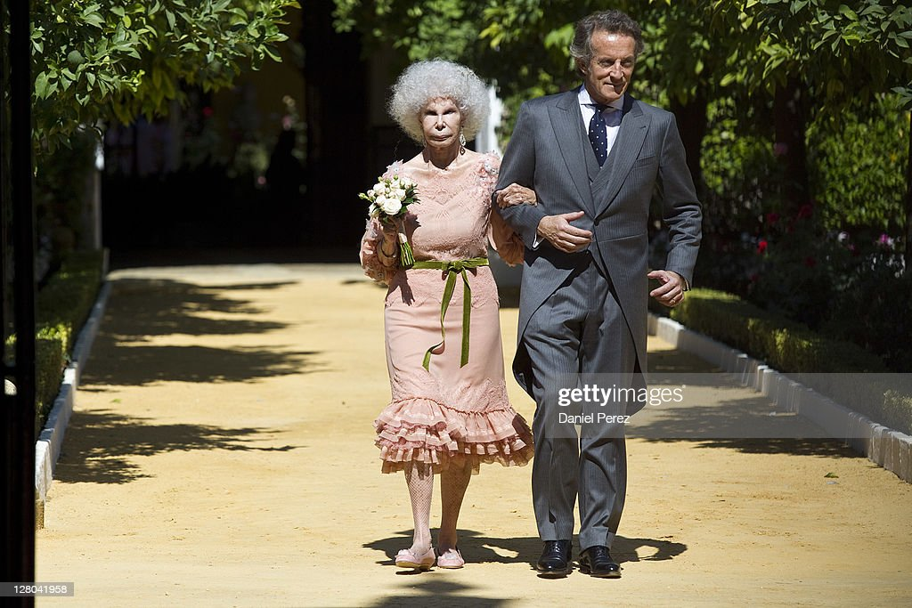Spain's Duchess of Alba, Maria del Rosario Cayetana Fitz-James-Stuart and her husband <a gi-track='captionPersonalityLinkClicked' href=/galleries/search?phrase=Alfonso+Diez&family=editorial&specificpeople=6697714 ng-click='$event.stopPropagation()'>Alfonso Diez</a> walk towards photographers after their wedding ceremony at the Palacio de las Duenas on October 5, 2011 in Seville, Spain.