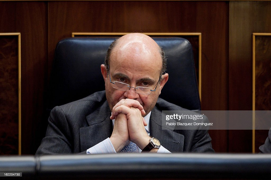 Spain's Economy and Competitiveness Minister <a gi-track='captionPersonalityLinkClicked' href=/galleries/search?phrase=Luis+de+Guindos&family=editorial&specificpeople=8756055 ng-click='$event.stopPropagation()'>Luis de Guindos</a> listens during Mariano Rajoy's first State of Nation Debate as Prime Minister at Parliament on February 20, 2013 in Madrid, Spain. Rajoy said his government managed to keep Spain's public deficit under 7 percent of Gross Domestic Product. He lamented the unemployment figures of 6 million and signalled his intention to bring new laws to tackle political corruption.