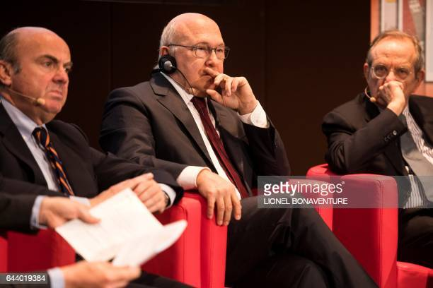 Spain's Economy minister Luis de Guindos French Economy minister Michel Sapin and Italy's Economy minister Pier Carlo Padoan take part in the 10th...