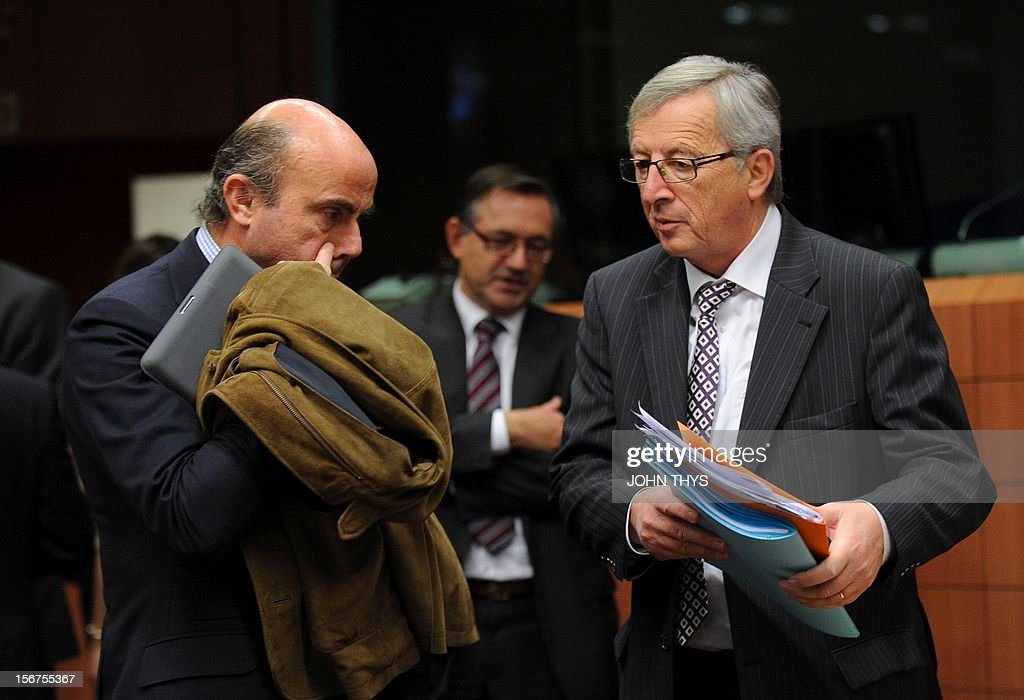 Spain's Economy minister Luis de Guindos Jurados (L) speaks with Luxembourg Prime Minister and Eurogroup Council president Jean-Claude Juncker (R) before an Eurozone finance ministers meeting to decide on a fresh rescue loan for debt-stricken Greece, on November 20, 2012 at EU headquarters in Brussels. Greece has 'delivered' on reform and a deal will likely be clinched to unblock funds to keep it from bankruptcy, the head of the Eurogroup insisted despite a split with the IMF over how to get the stricken country's economic recovery on track.