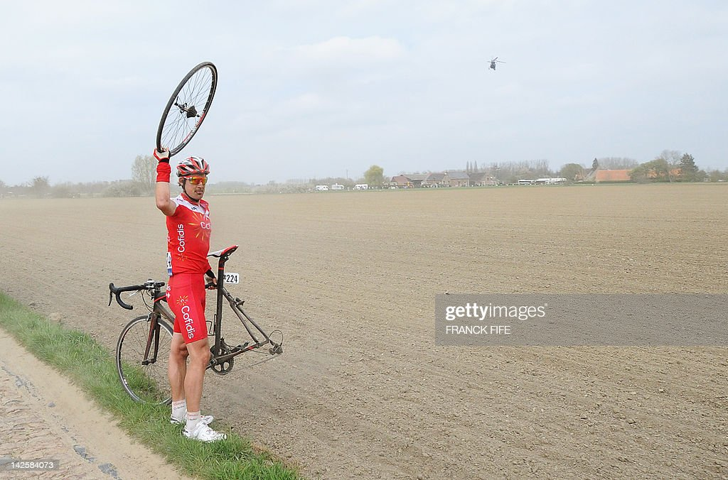 Spain's Egoitz Garcia of team Cofidis asks for help on the roadside during the 110th edition of the Paris-Roubaix one-day classic cycling race, on April 8, 2012, in Roubaix, northern France. Boonen, who had previously won in 2005, 2008 and 2009, equals the record of wins in Paris-Roubaix held by compatriot Roger De Vlaeminck. Boonen won the race ahead of French Sebastien Turgot (Team Europcar) and Italian Alessandro Ballan (Team BMC).