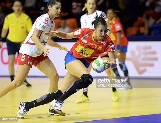 Spain's Elisabet Chavez plays the ball during the first match Spain vs Poland of the 2014 European Women's Handball Championships at the Audi Arena...