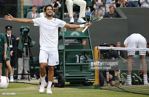 Spain's Feliciano Lopez celebrates winning his men's singles third round match against US player John Isner on day seven of the 2014 Wimbledon...