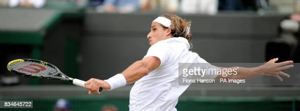 Spain's Feliciano Lopez in action against Russia's Marat Safin during the Wimbledon Championships 2008 at the All England Tennis Club in Wimbledon
