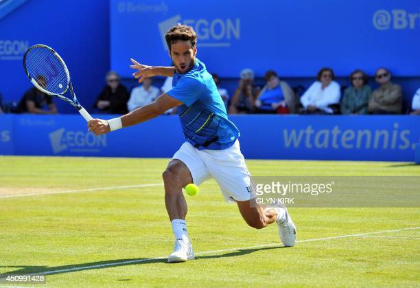 Spain's Feliciano Lopez returns to France's Richard Gasquet during their Men's Singles final match on the last day of the Aegon International tennis...