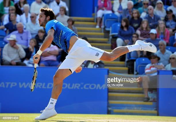 Spain's Feliciano Lopezserves to France's Richard Gasquet during their Men's Singles final match on the last day of the Aegon International tennis...