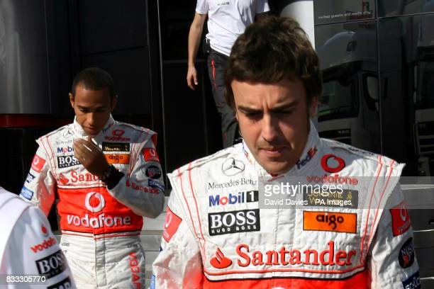 Spain's Fernando Alonso and Great Britain's Lewis Hamilton leave the McLaren Motor home during the Hungarian Grand Prix at the Hungaroring circuit...