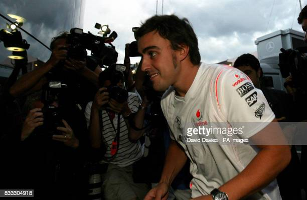 Spain's Fernando Alonso arrives back at the McLaren motorhome after attending a stewrds meeting after qualifying at the Hungaroring circuit near...