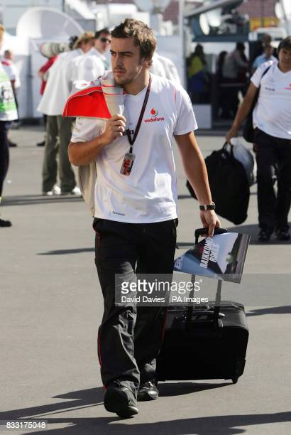 Spain's Fernando Alonso arrives for the European Formula One Grand Prix at Nurburgring Germany