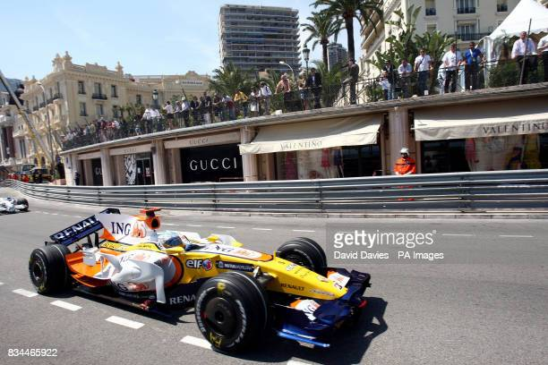 Spain's Fernando Alonso in his Renault is forced to slow down due to a broken rear wing during the practice session at Monte Carlo Monaco