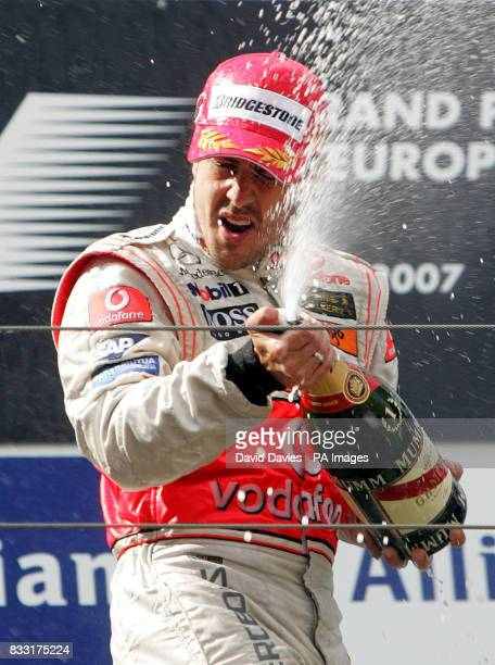 Spain's Fernando Alonso of McLaren Mercedes celebrates with champagne during the presentation ceremony after winning the European Formula One Grand...