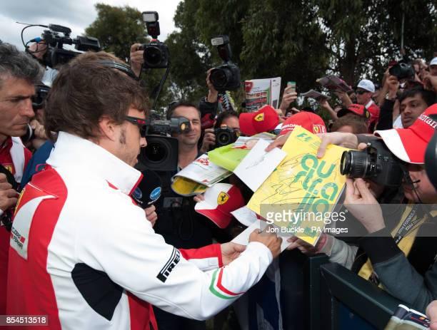 Spain's Fernando Alonso of Scuderia Ferrari signs autographs for fans ahead of the 2014 Australian Grand Prix at Albert Park Melbourne Australia