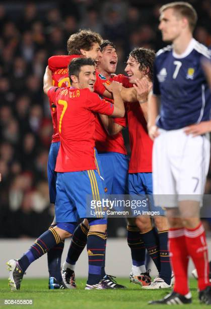 Spain's Fernando Llorente celebrates scoring the winning goal as Scotland's Darren Fletcher stands dejected during the UEFA Euro 2012 Qualifying...