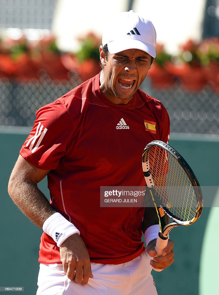 Spain's Fernando Verdasco celebrates after winning a point against Ukraine's Alexander Dolgopolov during the World Group Play-offs 2013 at the Caja Magica sports complex in Madrid on September 13, 2013. Winning nations qualify for the World Group in 2014.