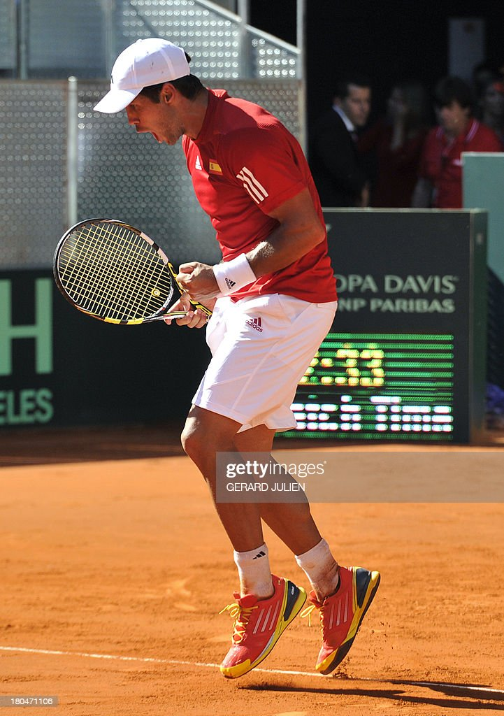 Spain's Fernando Verdasco celebrates after winning his tennis match against Ukraine's Alexander Dolgopolov during the Davis Cup World Group play-off 2013 at the Caja Magica sports complex in Madrid on September 13, 2013.