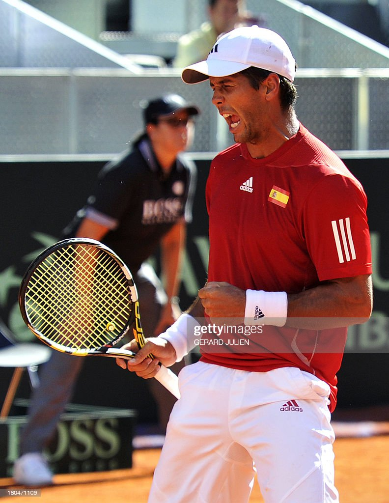 Spain's Fernando Verdasco celebrates after winning his tennis match against Ukraine's Alexander Dolgopolov during the Davis Cup World Group play-off 2013 at the Caja Magica sports complex in Madrid on September 13, 2013. AFP PHOTO / GERARD JULIEN
