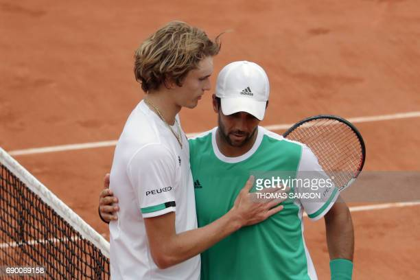 Spain's Fernando Verdasco hugs Germany's Alexander Zverev after winning their tennis match at the Roland Garros 2017 French Open on May 30 2017 in...